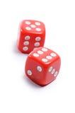 Cubos rojos para el póker en el fondo blanco Imágenes de archivo libres de regalías