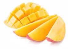Cubos y rebanadas del mango fotos de archivo libres de regalías