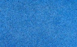 Cubra con grava el fondo del pavimento para el aire libre en color azul foto de archivo