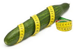 Cubumber wrapped in a tape measure Stock Images