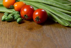 Cucamelons, orange and red tomatoes and runner beans Royalty Free Stock Images