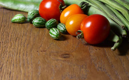 Cucamelons with red and orange tomatoes and runner beans Royalty Free Stock Photo