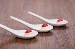 3 cucchiai con il formaggio del coltivatore Fotografie Stock