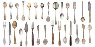 Cucchiai d'annata, forchette e coltello della raccolta isolati su un fondo bianco Retro argenteria immagine stock libera da diritti