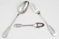 Cucchiai d'argento e forchetta d'argento Fotografie Stock Libere da Diritti