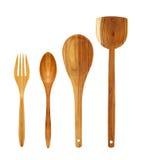 Cucchiai di legno e forchetta isolati su bianco Fotografia Stock Libera da Diritti