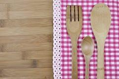Cucchiai di legno e una forchetta Fotografia Stock Libera da Diritti