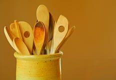 Cucchiai di legno in pulviscolo Fotografia Stock