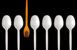 Cucchiai e forchetta di plastica Fotografie Stock
