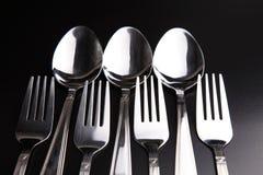 Cucchiai e forchette Immagini Stock