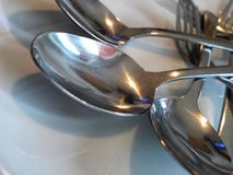 Cucchiai inossidabili fotografie stock