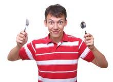 Cucchiaio affamato isolato della forcella dell'allievo del giovane Fotografia Stock Libera da Diritti