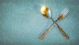 Cucchiaio d'annata e forchetta Immagine Stock