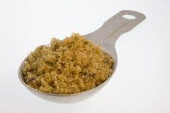 Cucchiaio da tavola di zucchero marrone Immagini Stock