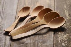 Cucchiaio di legno cinque Fotografia Stock