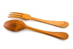 Cucchiaio e forchetta di legno. Isolato, con il residuo della potatura meccanica Immagini Stock Libere da Diritti