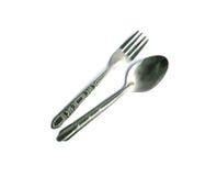 Cucchiaio e forchetta su fondo bianco Fotografia Stock