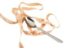 Cucchiaio e nastro di misurazione Immagini Stock Libere da Diritti
