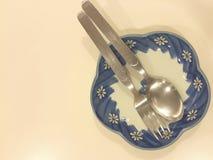 Cucchiaio e piatto della forcella Immagine Stock