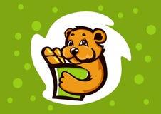 Cucciolo di orso con un pacchetto del pane Fotografia Stock Libera da Diritti