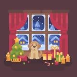 Cucciolo sveglio che si siede alla finestra con un paesaggio nevoso di inverno Fotografia Stock