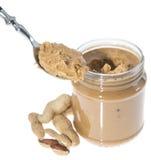 Cuchara con mantequilla de cacahuete Foto de archivo libre de regalías