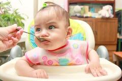 Cuchara de alimentación del bebé Imagen de archivo libre de regalías
