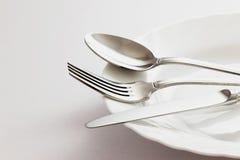 Cuchara de la bifurcación y cuchillo de tabla Imagen de archivo libre de regalías
