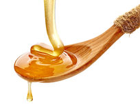 Cuchara de madera con la miel Imagen de archivo libre de regalías