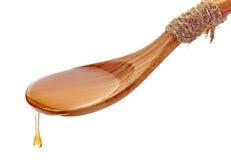 Cuchara de madera con la miel Imagenes de archivo