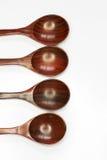 Cuchara de madera en el fondo blanco Imagen de archivo libre de regalías