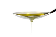 Cuchara del aceite de oliva Imagen de archivo libre de regalías