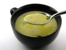 Cuchara por completo de la sopa Fotos de archivo