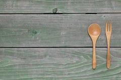 Cuchara y bifurcación de madera, cuchillo Foto de archivo libre de regalías