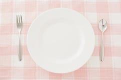 Cuchara y fork blancas de la placa Foto de archivo libre de regalías