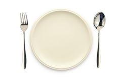 Cuchara y fork blancas vacías del plato Fotos de archivo