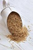 Cucharada del arroz moreno Foto de archivo