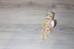 Cucharada plástica en la tabla Fotografía de archivo libre de regalías