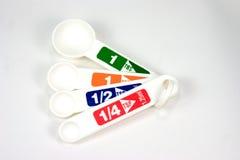 Cucharas dosificadoras Fotos de archivo libres de regalías