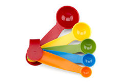 Cucharas dosificadoras coloridas Fotos de archivo
