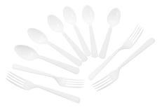 Cucharas y forkes plásticas Foto de archivo libre de regalías