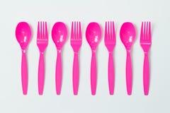 Cucharas y forkes plásticas Fotos de archivo