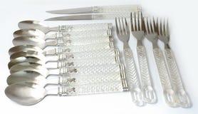 Cucharas y knifes y maneta transparente de las forkes Imagen de archivo