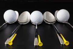 Cucharas y pelotas de golf Imagen de archivo libre de regalías