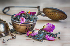 Cucharee y un cilindro para el té, vintage, retro, Fotos de archivo libres de regalías
