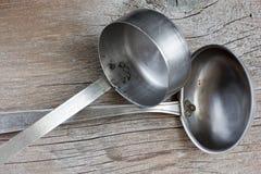 Cucharones de sopa viejas del metal del vintage Imagen de archivo libre de regalías