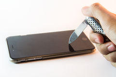 Cuchillo colocado en el teléfono móvil Imagen de archivo libre de regalías