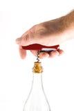 Cuchillo de bolsillo con un sacacorchos y una botella Imágenes de archivo libres de regalías