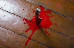 Cuchillo de cocina en sangre Imagen de archivo libre de regalías