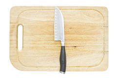 Cuchillo de cocina en una tabla de cortar Foto de archivo libre de regalías